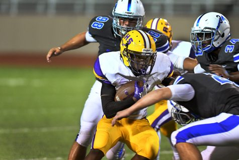 Senior Deon Gallington attempts to evade the Midlothian tackler. The Eagles are looking forward to the rivalry game against Pearce HS, despite injuries on the team. Photo by Ryan Durbin