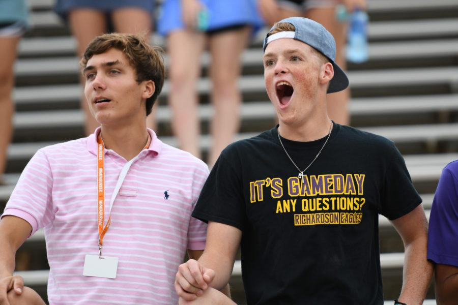 Seniors Brandon Harrison and Caleb Combs cheer on their team at the Naaman Forest HS  football game. Photo by Brielle Bishop