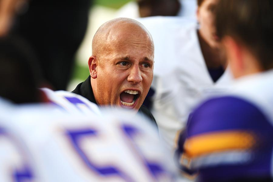 Head Coach and Athletic Director Greg Pels motivates the varsity football team during the game against Irving Nimitz. The Eagles are looking forward to the rivalry game against Pearce HS, despite injuries on the team. Photo by Chad Byrd