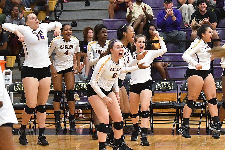 Varsity volleyball celebrates a point in the second set. They went on to lose the match 3-2 vs. Pearce. Photo By Brantley Graham