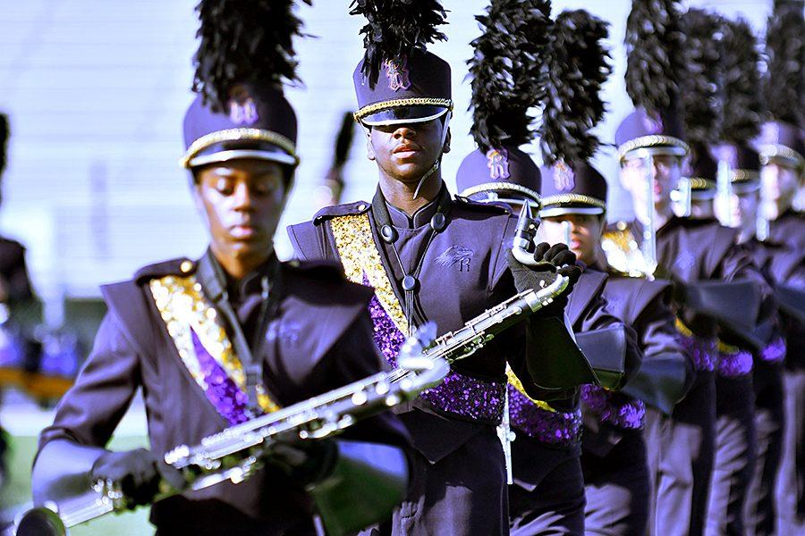 Junior Kordell Pope grips his bass clarinet as the marching band marches to Set 5 at the Desoto Marching Classic on Saturday, where Richardson placed third. Photo by Brantley Graham