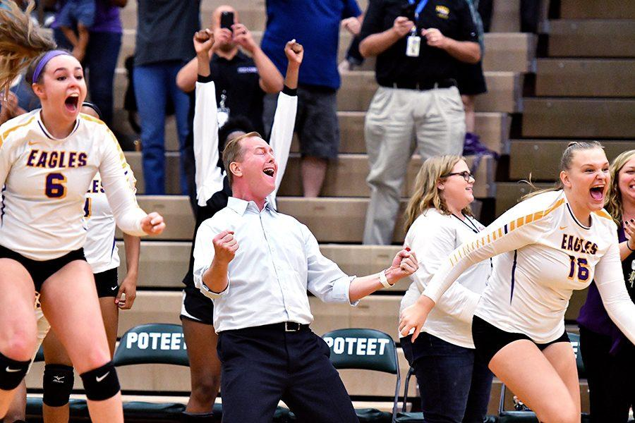 Head Coach Eric Miracle celebrates a victory over Rowlett Tusday night making the Varsity Volleyball team Bi-District Champions for the first time since 2009. Talon Photo by Brielle Bishop