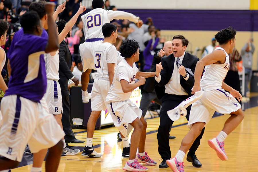 Boys basketball coach Justin Reese rejoices during a game against Skyline. Photo by Madison Staggenborg