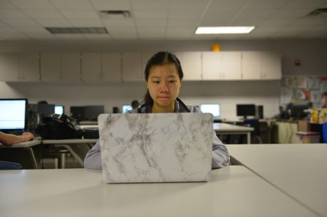 Senior Emily Chen volunteered for the Digital Divas competition, where girls solve levels with their knowledge of computer science. Photo by Brantley Graham