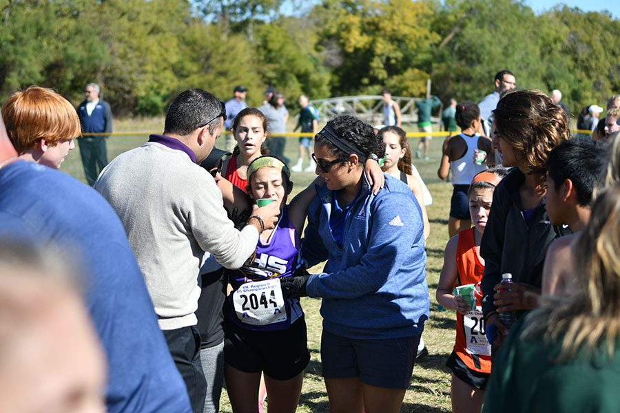 Brianna Farias is provided water by an athletic trainer and her dad after her run. Talon Photo by Ali Nosrat