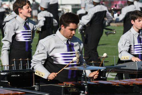 Senior front ensemble captain, James Camp, performs at the Desoto Marching Competition. The band placed third for the second consecutive year. Talon photo by Ali Nosrat