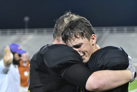 Seniors Jordan Wander and Nic smith embrace after a 42-37 victory over W.T. White, ending a 21-game losing streak. Talon photo by Daphne Lynd
