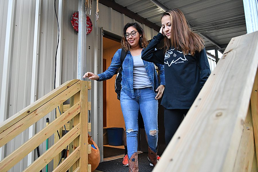 Seniors Emily Popoca and Elizabeth Benitez  exiting the AP Environmental Science portable after class. After the bond passed for $437 million towards RISD schools, APES has had the opportunity to update their space. In the mean time class is held in the portables.