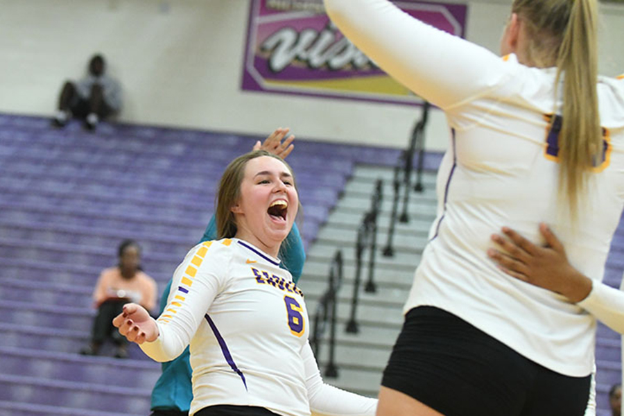 Senior Allie Cunyus celebrates a point at a home game against Coppell high school. Talon photo by Chad Byrd.