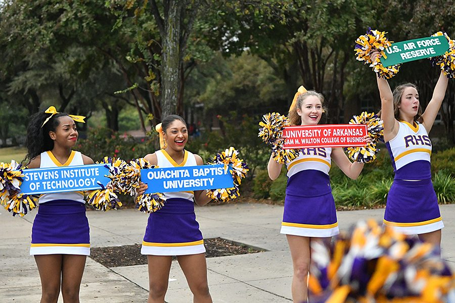Seniors Dasia Williams, Jordyn Strange, Kayla Morren and Nicole Cochran cheer as guests enter the front of the school to take part in AVID Showcase where educators come to learn how to better serve student populations using AVID strategies.
