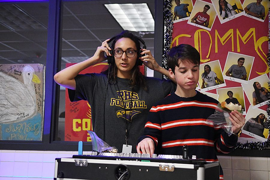 Senior+Gaby+Fernandez+and+Junior+Ben+Goldberg+work+on+the+Communications+DJ+equipment+and+play+music+for+the+8th+Graders+visiting+the+school.+Talon+Photo+By+Henry+Carpenter