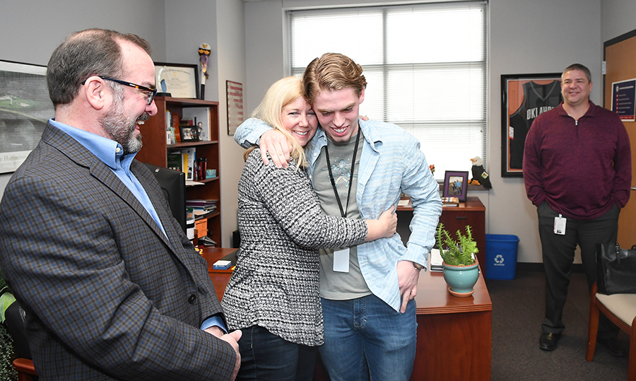 After hearing the news that he was appointed to the United States Merchant Marine Academy, Patrick Mishler congradulates by his mom Elaine Mishler with his Father Randy Misher and head Principal Chris Choat looking on.  photo by Chad Byrd