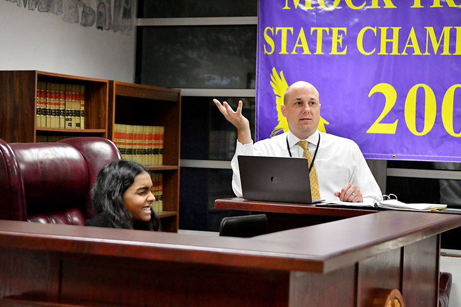 New Law teacher Brian Sheguit critiques a direct examination while freshman Natasha Kokkodil acts as the judge.