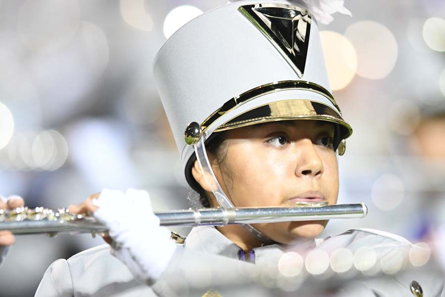 Freshman Abgial Ortega plays her flute during the pearce game during the half time show of the Arabian Nights