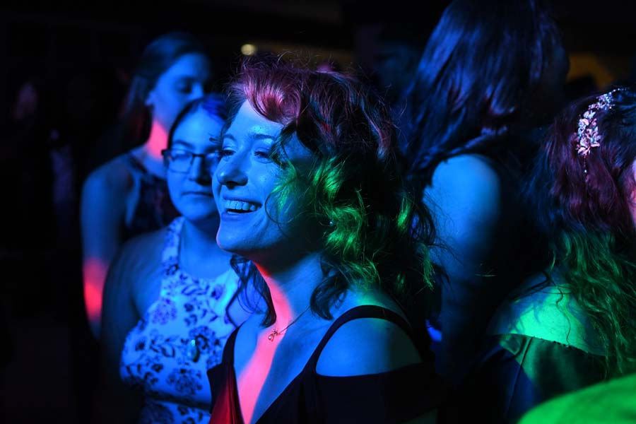 """Junior Samantha Vassen laughs as the neon lighst flash at homecoming. """"I went freshman year and back then I was more antisocial and just played video games, but this year I just wanted to be myself and dance and not care what anyone else thought. I had lots of fun with friends,"""" said Vassen."""