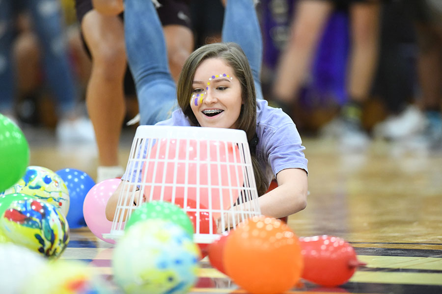 During the Homecoming pep rally junior Kylee Morren is pushed by teammate Noah Ledat while playing a game of