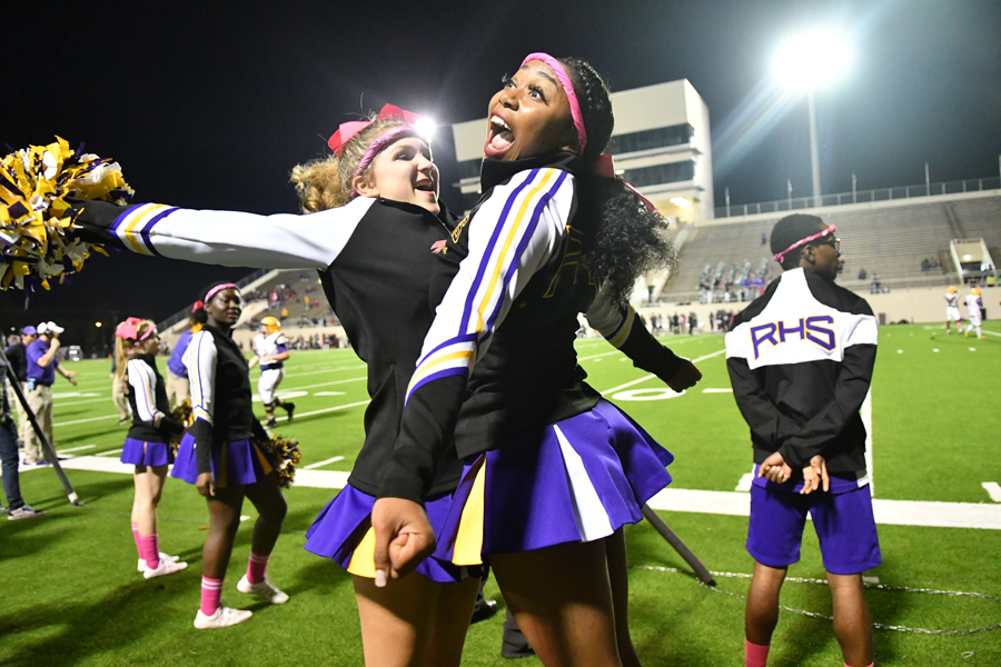 "Senior Ciara Lee chestbumps junior Emma Brantley at the Berkner game. ""I love to help little girls and inspire little girls to become like me. It brings a positive vibe. I love to be happy and be positive all the time,"" Lee said. Talon photo by Daphne Lynd"