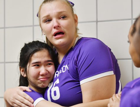 "After a first round loss to top ranked Waxahachie in the UIL volleyball playoffs, senior Payton Cerny hugged teammate Emily Huynh with tears streaming down her face. ""I was thinking about just how quick my time on the team flew by, and how I'll miss playing with them,"" Cerny said. Talon photo by Yessi Lipscomb"