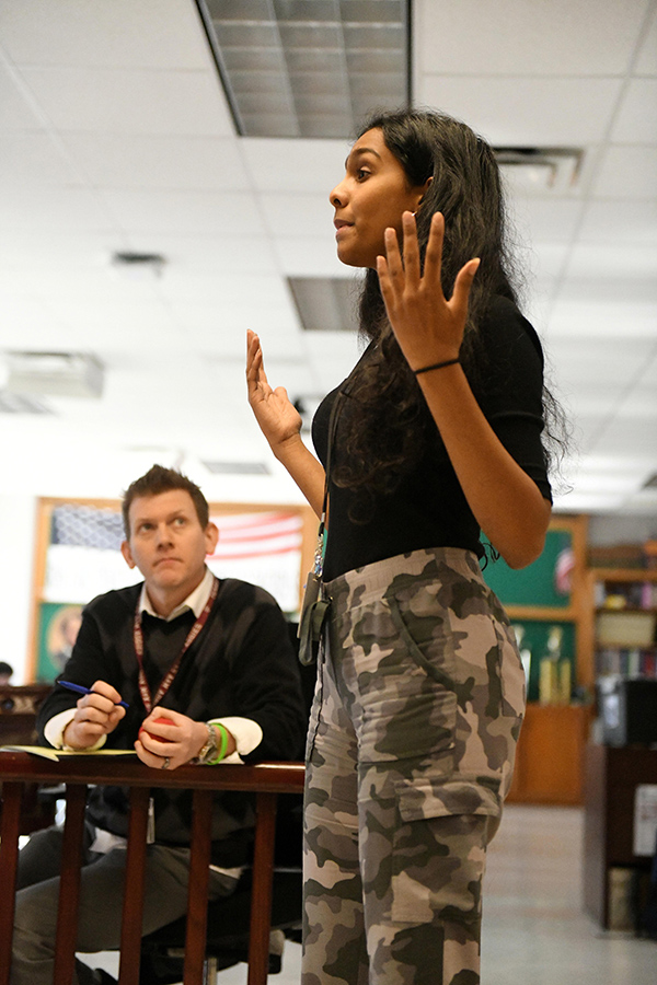 New law teacher Chris Bufkin listens to his student present a case. Talon photo by Daphne Lynd