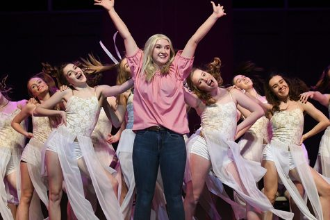 "Senior Morgan Peterson throws her hands up in the number ""So much Better"" as the chorus bounces back and forth behind her.  Talon photo by Daphne Lynd"