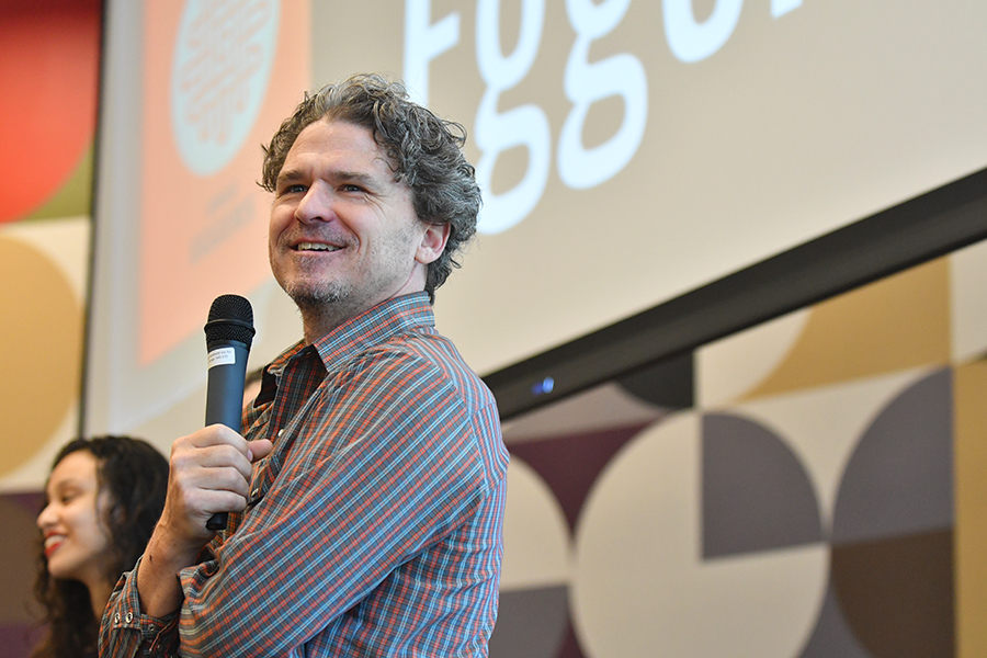 Author Dave Eggers debates the pros and cons of techonogly with the student filled crowd. Photo by Chad Byrd
