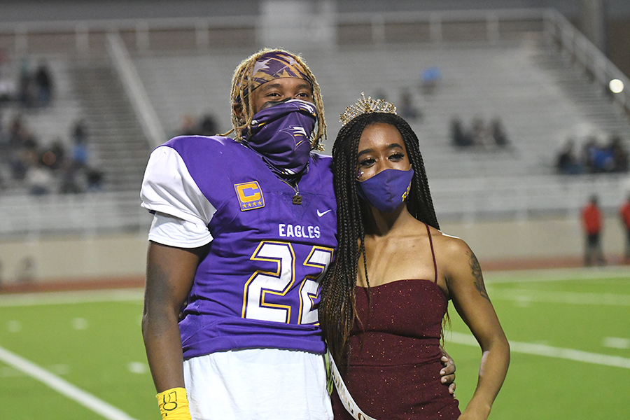 Senior Mya Johnson stands with Senior Marcellus Dennis after being named homecoming queen. Mya was crowned at the MacArthur home game to make up for missing the homecoming game after being contact traced. Talon Photo by Mallory Derrick Photo credit: Mallory Derrick